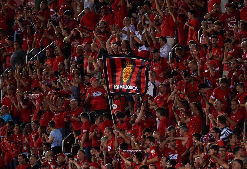RCD Mallorca supporters celebrate after their team scored during the play off second leg match between Deportivo de La Coruna and Mallorca at Iberostar Stadium on June 23, 2019 in Mallorca, Spain.