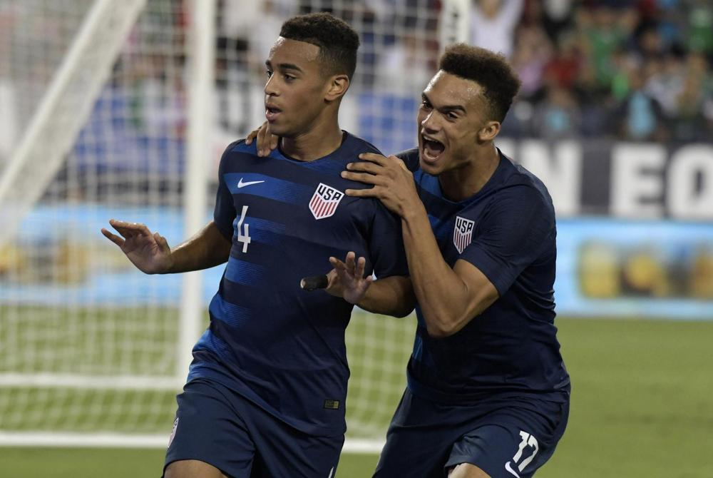 United States midfielder Tyler Adams (4) celebrates with defender Antonee Robinson (17) after scoring a goal against Mexico in the second half during an international friendly soccer match at Nissan Stadium. Mandatory Credit: Kirby Lee-USA TODAY Sports