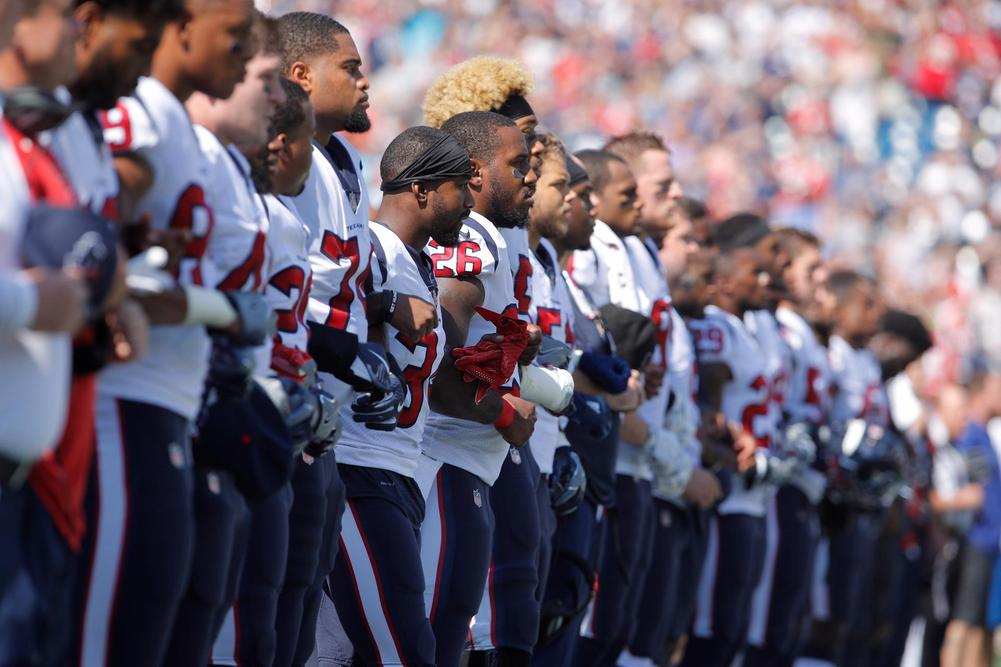 Many of Texans players kneel during national anthem in protest of owner