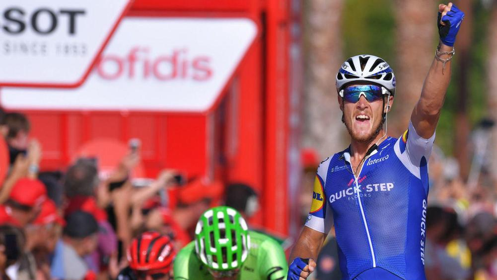 Lampaert leads Vuelta as riders face winds, passing train