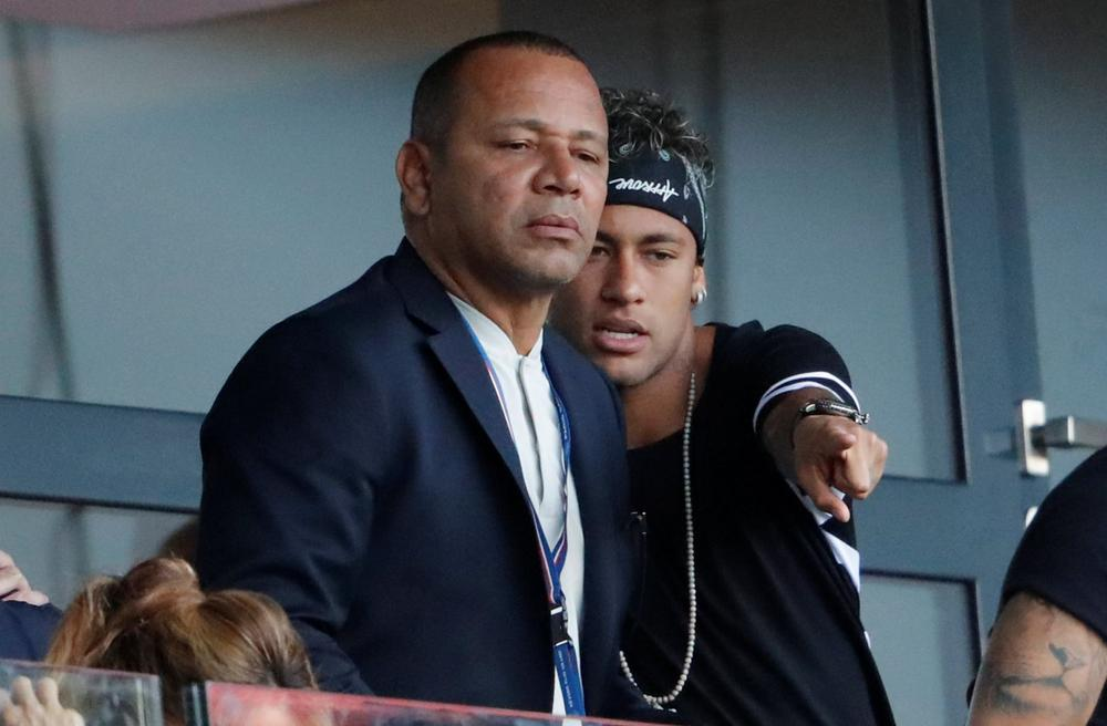 Paris Saint-Germain's Neymar watches his team play against Amiens from the stands with his father, August 5, 2017 | beIN SPORTS USA