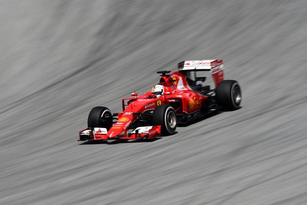Sebastian Vettel closed out his maiden Ferrari win as the 2015 Formula One season took a huge early twist at the Malaysia Grand Prix.