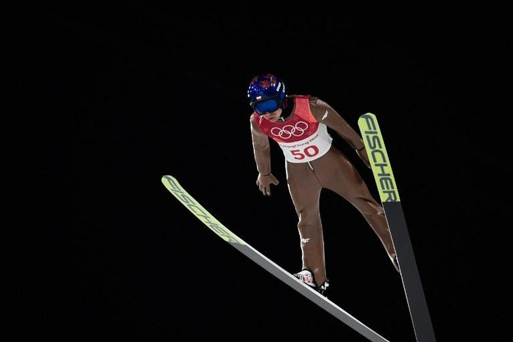 Stoch retains Olympic ski jump title with last leap