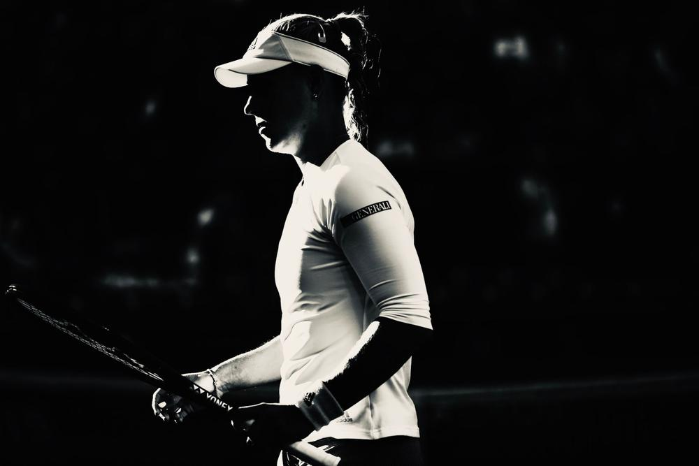 Angelique Kerber in black and white holding her tennis raquet at the Indian Wells Open where she cruises into the final with a win | beIN SPORTS USA