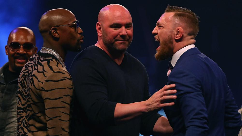 Mayweather vs. McGregor Simmers in Eclipse Shadow