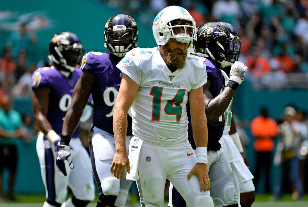 Miami Dolphins quarterback Ryan Fitzpatrick reacts after being sacked during the first half of the NFL season against the Baltimore Ravens at Hard Rock Stadium   beIN SPORTS USA