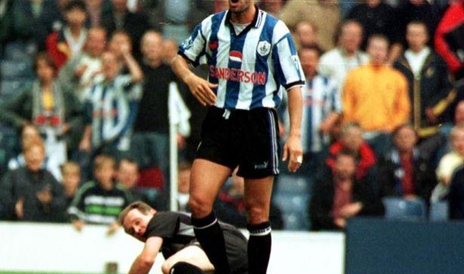 Sheffield Wednesday's Paulo Di Canio moments after pushing over referee Paul Alcock in 1998