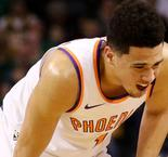 Suns star Booker carried off court after groin injury