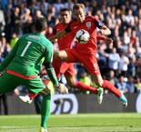 Kane rescues England after wild finale in Scotland