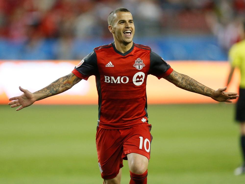Toronto FC forward Sebastian Giovinco (10) celebrates after scoring a goal against the Philadelphia Union on a penalty kick during the first half at BMO Field.