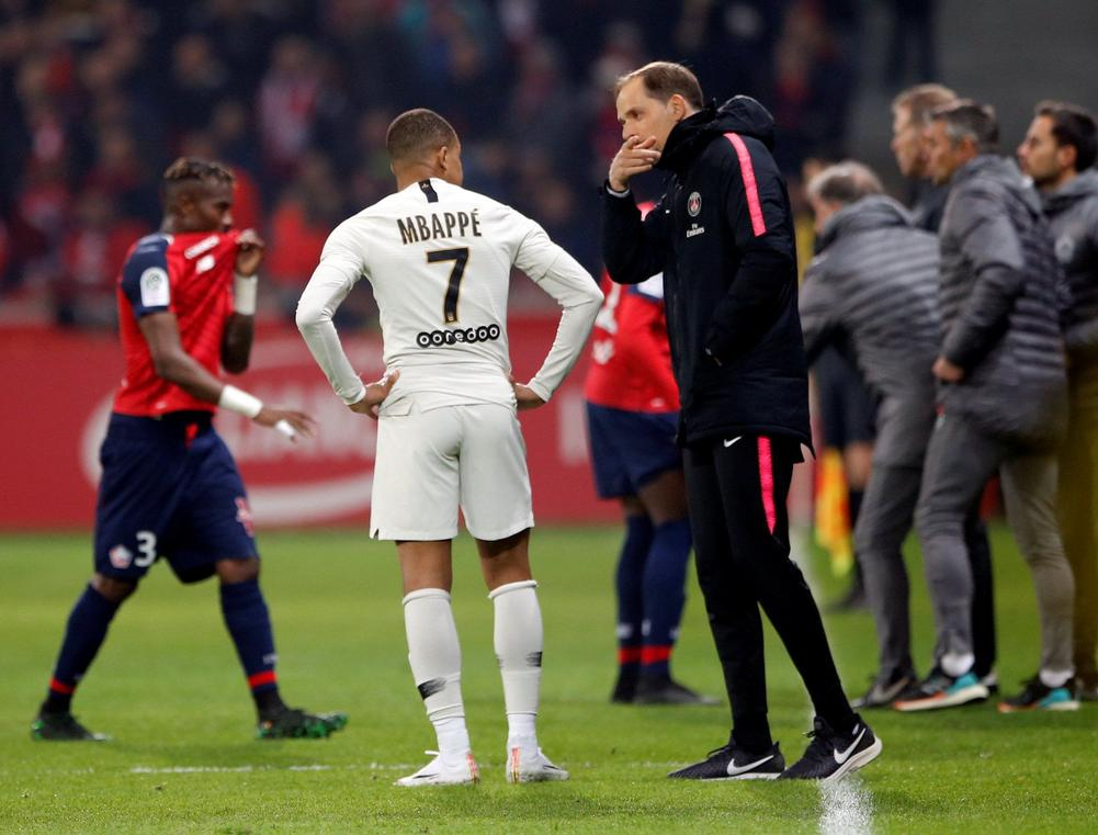 Paris Saint-Germain coach Thomas Tuchel gives Kylian Mbappe instructions during a 5-1 defeat to Ligue 1 rivals Lille, April 12, 2019 | beIN SPORTS USA