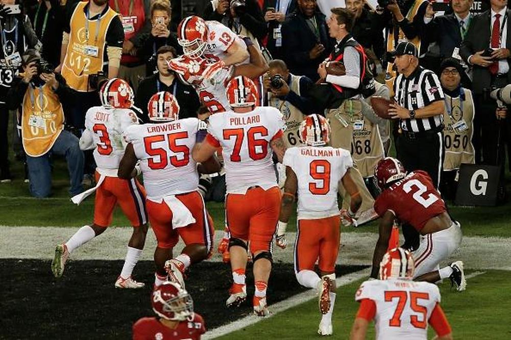 TAMPA, FL - JANUARY 09: Wide receiver Hunter Renfrow #13 of the Clemson Tigers celebrates with teammates after making a 2-yard game-winning touchdown reception against defensive back Tony Brown #2 of the Alabama Crimson Tide during the fourth quarter of t
