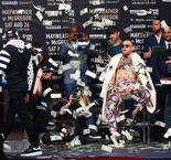 Floyd Mayweather Showers Conor McGregor With Money