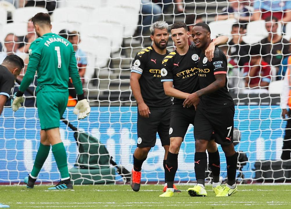 Raheem Sterling celebrates scoring a hat-trick and Manchester City's fifth goal against West Ham United Soccer Football - London Stadium, London, Britain - August 10, 2019 | beIN SPORTS USA