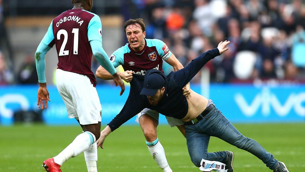 Ugly scenes as pitch invasions halt West Ham defeat to Burnley
