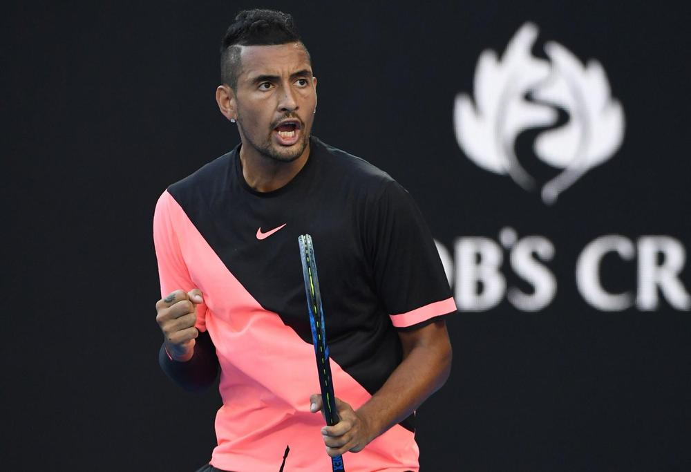 Australian Open: Nick Kyrgios ignores heckler and helicopter to beat Viktor Troicki