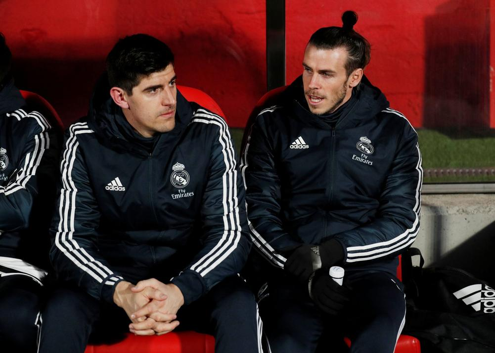 Real Madrid's Thibaut Courtois and Gareth Bale on the bench before a Copa del Rey quarter-final clash with Girona