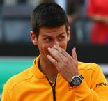 Djokovic unscathed after champagne incident