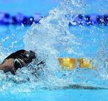 Health scare for Ledecky, Sun survives at world swimming