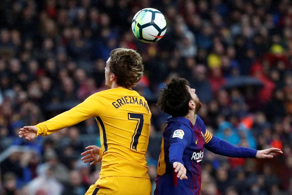 Atletico Madrid's Antoine Griezmann competes with Barcelona's Lionel Messi for an aerial ball, Camp Nou, Barcelona, Spain - March 4, 2018   beIN SPORTS USA
