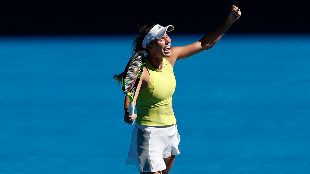 Wozniacki pulls off great escape to make third round